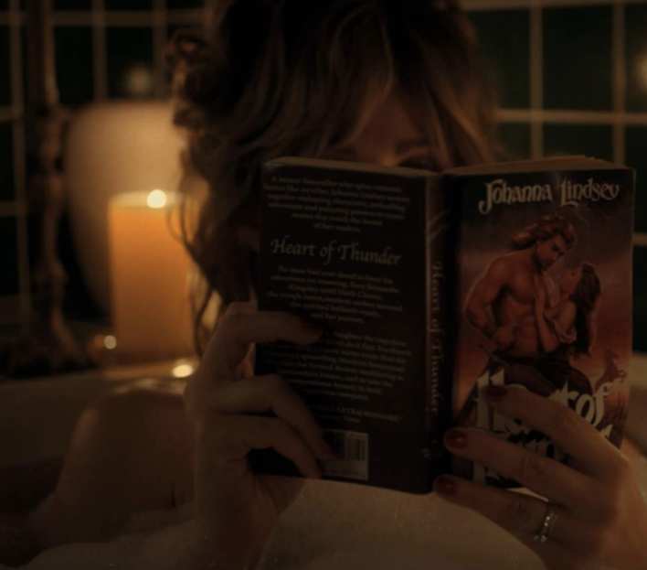 Karen Wheeler reading her romance novel